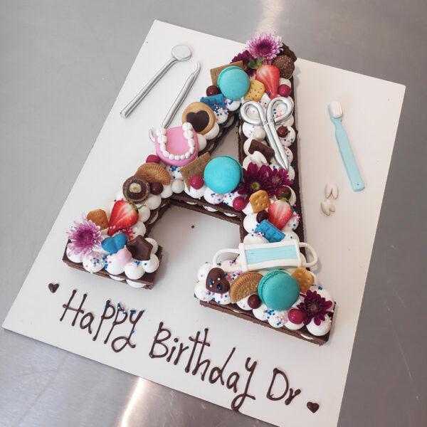 کیک حروف تم دندان پزشک اجرا شده توسط نگار رزاقی